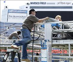 Workers prepare scaffolding at Invesco Field at Mile High on Sunday for Barack Obama's Thursday acceptance speech, concluding Denver's Democratic National Convention.