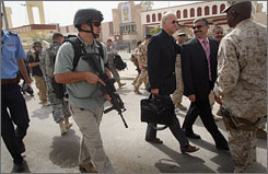 Sen. Joe Biden, D-Del., carrying the briefcase, visits Ramadi, Iraq, on Sept. 6, 2007. Private contractors help the United States provide security when diplomats and other VIPs visit Iraq.