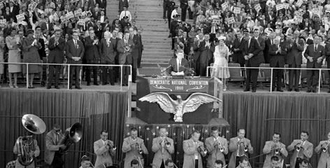 Sen. John F. Kennedy gets a standing ovation as he steps to the speaker's podium to accept the Democratic party's nomination for president in the Los Angeles Coliseum on July 15, 1960.