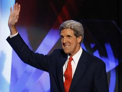 Sen. John Kerry greets the crowd at the Democratic National Convention on Wednesday, when he listed what he said were Sen. John McCain's changes of position since he became a presidential candidate.