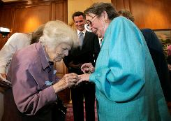 Del Martin, left, places a ring on her partner Phyllis Lyon on June 16 during a wedding ceremony officiated by San Francisco Mayor Gavin Newsom. Martin, a pioneering lesbian rights activist who married her lifelong partner on the first day same-sex couples could legally wed in California, has died at 87.