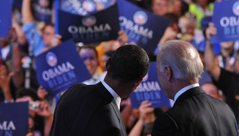 Sens. Barack Obama and Joe Biden stand before the Pepsi Center crowd Wednesday night at the Democratic National Convention.