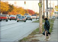 A prostitute works during evening rush hour on 8 mile road in Detroit in 2002 just east of the State Fairgrounds.