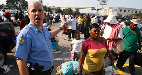 New Orleans sheriff deputy Jerry Greco directs evacuees outside the New Orleans Union Passenger Terminal on Saturday.