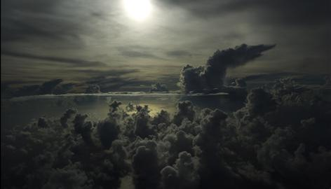 Clouds from Hurricane Gustav form over the Caribbean Sea between Jamaica and the Cayman Islands, late Friday as a C-130 Hercules airplane flies over to collect data for the National Hurricane Center.