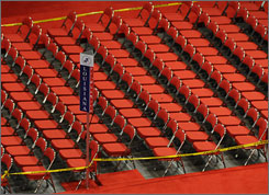 Seats for the Louisiana delegation remain empty at the Republican National Convention in St. Paul.