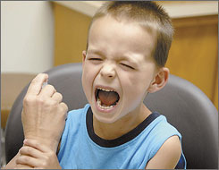 Marcus Gent, 5, yells as he gets his chicken pox vaccination at the Sidney-Shelby County Health Department in Sidney, Ohio.