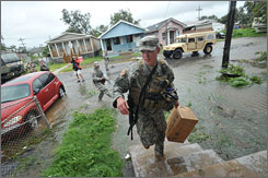 Army Guardsman Staff Sgt. Mike Poulk helps deliver supplies Monday to some who rode out Hurricane Gustav in New Orleans.
