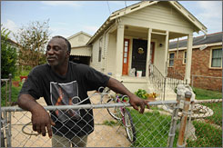 Clarence Green surveys his neighborhood for damage Tuesday.