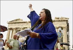Doretta Peppa raises her fist during a prayer in front of the temple of the Parthenon in Athens August 31.
