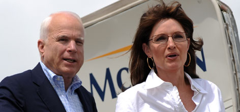 John McCain and his running mate Alaska Gov. Sarah Palin board McCain's campaign airplane Sunday in Jackson, Miss., after a visit to the command center at the Mississippi Emergency Management Agency.