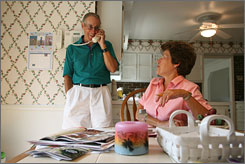 Bob Blackwell and his wife, Carol, share a few laughs as she goes through travel catalogues in preparation for a trip overseas. Though he has been diagnosed with early-stage Alzheimer's, the Blackwells lead an active life.