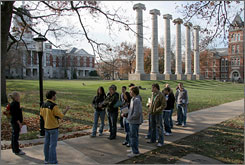 Prospective students follow their student tour guide at the University of Missouri in Columbia, Mo. Last week the university welcomed about 785 more freshmen than last year.