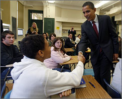 "Barack Obama shakes hands with students at Manchester Central High School in Manchester, N.H., in November. The Democratic nominee supports ""merit pay,"" an idea many teachers oppose."