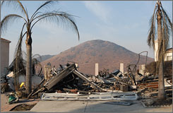 Two of the October fires merged to scorch more than 307 square miles, destroying 1,141 homes in the San Diego, Calif. area.