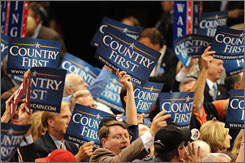 Delegates wave &quot;Country First&quot; signs during a speech at the final session of the Republican National Convention Thursday in St. Paul.
