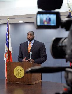 Detroit Mayor Kwame Kilpatrick addresses the media Thursday in Detroit. Kilpatrick took responsibility for his actions hours after resigning as part of plea deals in two criminal cases and left the door open for a return to public life.