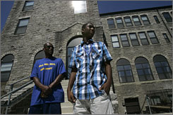 "Richard Cherry Jr., right, 15, leave Boys' Latin of Philadelphia with his father, Richard Cherry Sr.,  who said he sent his son there because he feared he'd get ""lost in the system"" at district high schools."