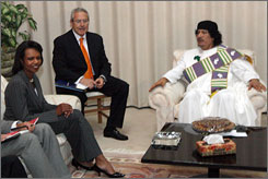 Libyan leader Moammar Gadhafi, right, meets with U.S. Secretary of State Condoleezza Rice, left, in Tripoli Friday marking the first such visit in more than half a century.