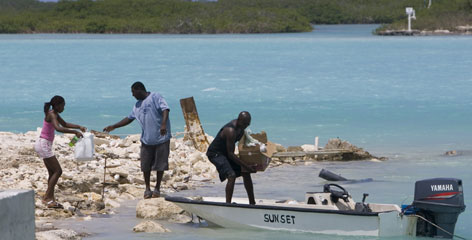Islanders load food supplies onto a speedboat bound for nearby North Caicos Island from the island of Providenciales in Turks and Caicos Saturday in preparation for Hurricane Ike.