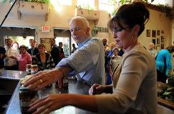 John McCain and Sarah Palin buy bottles of salsa on Sunday at a restaurant, in Albuquerque