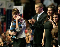 Sarah Palin holds Trig, her son with Down syndrome, at the GOP convention last week.
