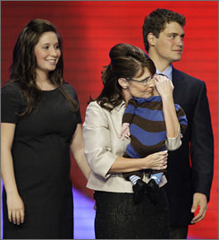 GOP vice presidential candidate Sarah Palin holds her son, Trig, as her pregnant daughter, Bristol,17, and Bristol's boyfriend, Levi Johnston join her on at the Republican National Convention in St. Paul, Wednesday.