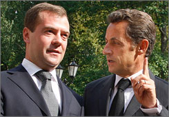 French President Nicolas Sarkozy, right, who also heads the European Union, speaks with Russian President Dmitry Medvedev, left, at the presidential residence in Moscow on Monday.