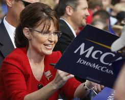 Republican vice presidential nominee Sarah Palin signs autographs Tuesday in Lancaster, Pa. A USA TODAY/Gallup poll shows the gender gap between campaigns closing.