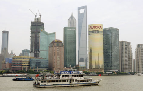 The newly built Shanghai World Financial Center stands taller than other high-rises near the Huangpu River.