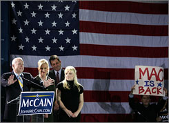 Republican presidential candidate John McCain speaks in January in Miami with his wife Cindy, center, and daughter Megan, right. The United Auto Workers union disapproves of John McCain's unclear message about whether he bought his daughter a hybrid car or if she bought it herself.