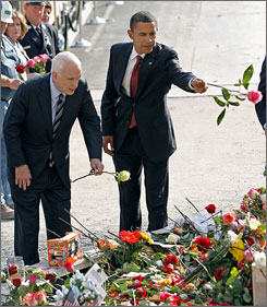 Republican presidential nominee John McCain, left, and Democratic nominee Barack Obama threw roses onto a reflecting pool as they visited the World Trade Center site Thursday.