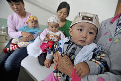 Parents wait at a hospital with babies suffering from kidney stones in Lanzhou, China. Public health authorities there are investigating baby formula after as many as 60 babies who drank it were hospitalized.