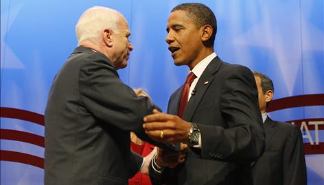 Republican presidential candidate Sen. John McCain greets Democratic presidential candidate Sen. Barack Obama Thursday at the midpoint of a forum on national service at Columbia University.