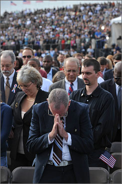 A crowd of 15,000 relatives of victims, Pentagon workers and guests attends the Pentagon Memorial unveiling.