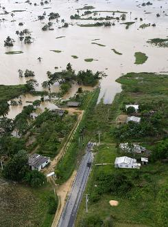 A highway is cut off by water Sept. 11 in the aftermath of Hurricane Ike in Pinar del Rio in western Cuba. Ike has caused widespread damage and a panorama of destruction in Cuba, still reeling from the more powerful Hurricane Gustav 10 days ago.