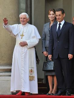 The four day trip Pope Benedict XVI took, seen here with Carla Bruni-Sarkozy and French President Nicolas Sarkozy, to Paris and Lourdes is seen as an attempt to reinvigorate Catholicism in France.