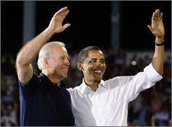 Vice presidential candidate Joe Biden, left, the Democratic senator from Delaware, earned a little over $300,000 last year, tax records show. Here, Biden is seen with Democratic presidential candidate Barack Obama, the senator from Illinois, greeting supporters in Battle Creek, Mich., on Aug. 31.