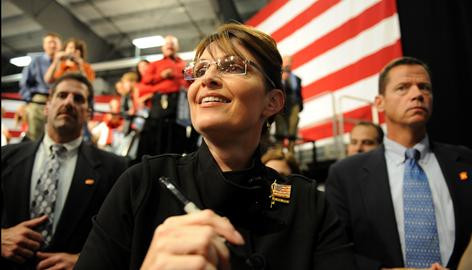 Republican vice presidential candidate Sarah Palin greets people at a rally Wednesday in Fairbanks. As governor, she has aligned with Democrats to tax the oil industry.