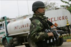 A soldier stands guard at the entrance of Guillermo Elder Bell refinery in Santa Cruz, Bolivia.