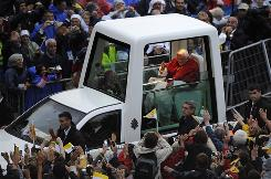 Pope Benedict XVI waves to the crowd as he arrives in his popemobile on Sept. 13 in the Sanctuary of Lourdes. The Pope will commemorate here the 150th anniversary of the Vatican-recognized apparitions of the Virgin Mary to peasant girl Bernadette Soubirous.