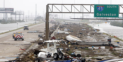 Debris litters the Galveston exit on I-45 on Saturday afternoon.