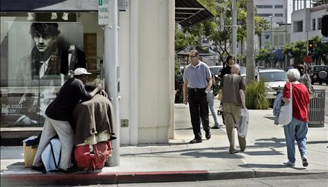 A homeless man looks for donations on a Beverly Hills corner on Sept. 11. The homeless in Beverly Hills present an incongruous sight amid the shows of superfluous wealth, but they've become fixtures of city life.