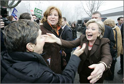 Hillary Rodham Clinton hugs a fan in Chappaqua, N.Y., after voting in the Feb. 5 Democratic primary, which she won.
