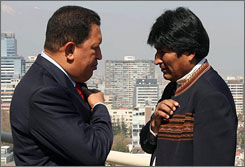 Venezuela's President Hugo Chavez, left, chats with Bolivian leftist president Evo Morales during a bilateral meeting in Santiago September 15.