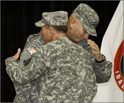 Gen. Ray Odierno, right, is congratulated by Gen. David Petraeus at Camp Victory in Baghdad.