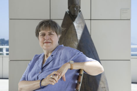 "Spiritual writer Kathleen Norris sits in front of the sculpture ""Seated Cardinal 1975-77"" at the Getty Center Museum in Los Angeles."