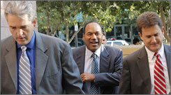 O.J. Simpson, center, and his lawyers Gabriel Grasso, left, and Yale Galanter arrive for his trial at a Las Vegas courthouse Tuesday.