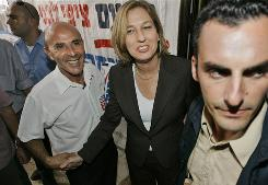 Israeli Foreign Minister and candidate for the Kadima party leadership Tzipi Livni, center, meets supporters at a voting station in Rehovot, Israel. Israel's popular foreign minister faced off against a grizzled former military chief in the leadership race for the ruling Kadima party.