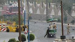 Yemeni soldiers take positions in front of the U.S. Embassy in San'a, Yemen Sept. 17 after a car bomb targeting the Embassy hit the front gate of the compound.
